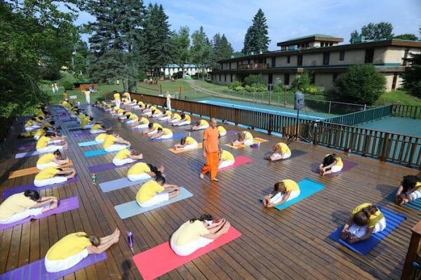 "<div style=""font-family: catamaran; color: #3c2c1e"">Ashram: Sivananda Yoga Camp</br><span style=""font-size: .8em"">Val Morin, Québec | Canada</span></div>"
